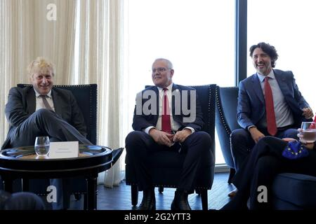 Carbis Bay, UK. 13th June, 2021. (From left to right) British Prime Minister Boris Johnson, Australian Prime Minister Scott Morrison, and Canadian Prime Minister Justin Trudeau during a break in meetings at the Carbis Bay Hotel on June 12, 2021, during the G7 Summit in Cornwall, United Kingdom. Photo by Andrew Parsons/No 10 Downing Street/UPI Credit: UPI/Alamy Live News
