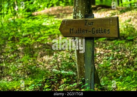 Marked hiking trails in Luxembourg. The sign points to the 'Mother of Christ'