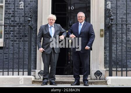 (210615) -- LONDON, June 15, 2021 (Xinhua) -- British Prime Minister Boris Johnson (L) greets Australian Prime Minister Scott Morrison in front of 10 Downing Street, in London, Britain, on June 15, 2021. Britain has secured a free trade deal with Australia -- the first major trade agreement negotiated from scratch since the former left the European Union (EU), the British government announced Tuesday. (Tim Hammond/No. 10 Downing Street/Handout via Xinhua)