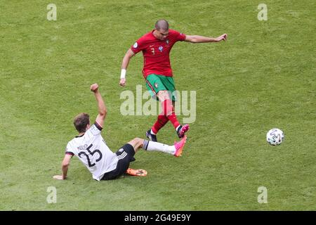 Munich, Germany. 19th June, 2021. Pepe (Top) of Portugal vies with Thomas Mueller of Germany during the UEFA Euro 2020 Championship Group F match in Munich, Germany, June 19, 2021. Credit: Shan Yuqi/Xinhua/Alamy Live News