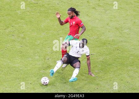 Munich, Germany. 19th June, 2021. Renato Sanches (top) of Portugal vies with Antonio Ruediger of Germany during the UEFA Euro 2020 Championship Group F match in Munich, Germany, June 19, 2021. Credit: Shan Yuqi/Xinhua/Alamy Live News
