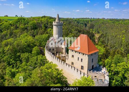 Aerial view of medieval castle Kokorin nearby Prague in Czechia. Central Europe. Medieval gothic castle Kokorin, Kokorinsko protected landscape area i