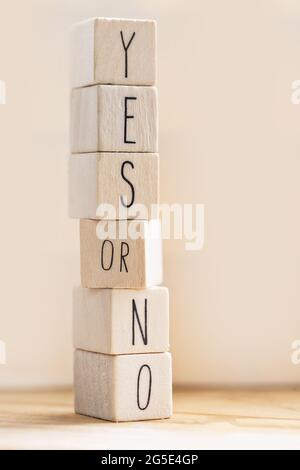 Yes versus no inscription on wooden cubes, balance,positivity,answers and question concept with copy space modern background