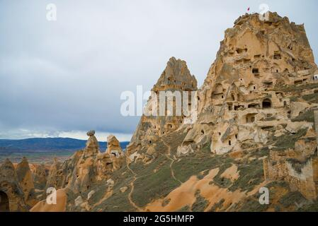 Cloudy January day at the cave fortified city of Uchisar. Cappadocia, Turkey