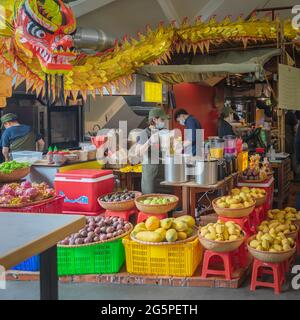 National cafe. Vietnamese food in market. Assortment of exotic tropical Asian fruits for natural juice making.