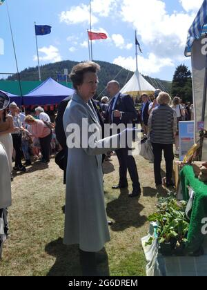 5 July 2021, St Johns, Isle of Man. No social distancing or masks. Her Royal Highness, Princess Anne, Princess Royal of the United Kingdom greeting people at a fair on an official visit to the Isle of Man where she presided over the open air sitting of Tynwald (the Parliament of the Isle of Man). The Princess seemed to enjoy her visit and was very generous with her time. She is shown here visiting a local farm shop at the Tynwald fair. The Isle of Man opened borders to non-residents on 28 June 2021 and has very few social distancing requirements (https://covid19.gov.im/).