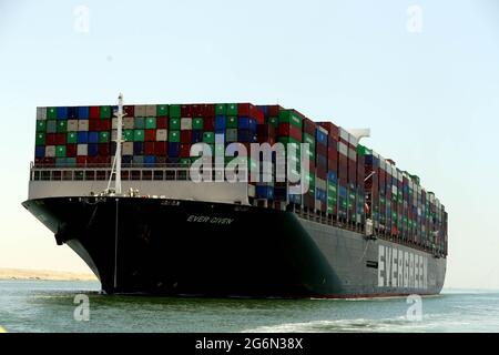 Ismailia. 7th July, 2021. Photo taken on July 7, 2021 shows the Ever Given container ship sailing on the Suez Canal in Ismailia Province, Egypt. The Ever Given container ship which blocked the Suez Canal for nearly a week in March began its journey out of the canal on Wednesday, said Suez Canal Authority (SCA) Chairman Osama Rabie. The SCA has held the giant ship in a lake between two stretches of the waterway since it was re-floated on March 29, as the dispute over requested compensation by the SCA was not settled. Credit: Ahmed Gomaa/Xinhua/Alamy Live News