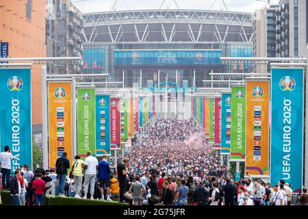 London, UK. 11th July, 2021. England fans outside Wembley Stadium ahead of the final of Euro 2020 between Italy and England. It is the first major final that England will have played in since winning the World Cup in 1966 and Italy remain unbeaten in their last 33 matches. Credit: Stephen Chung/Alamy Live News
