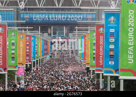 London, UK, July 11th 2021. Fans stream towards Wembley stadium for the much anticpated UEFA Euros 2020 final between England and Italy. Monica Wells/Alamy Live News