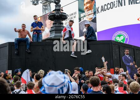 LONDON, UNITED KINGDOM. 11th, Jul 2021. The fans are gathered in the Euro 2020 Fan Zone at Piccadilly Circus prior tonight to the UEFA Euro 2020 Final between England vs Italy at Wembley Stadium on Sunday, 11 July 2021, LONDON, ENGLAND.  Credit: Taka G Wu/Alamy Live News