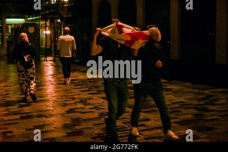 Brighton UK 11th July 2021 - England football fans head home in Brighton after watching the defeat on penalties to Italy in the EURO 2020 final  : Credit Simon Dack / Alamy Live News