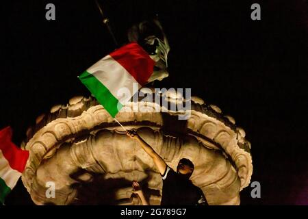 TRENTO, ITALY - JULY 11, 2021. Italian fans celebrate the victory of the Euro 2020 football championship after beating England in the final. Credit: Angela Krasniqi /Medialys Images/Alamy Live News