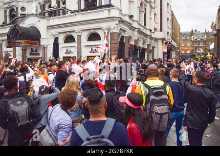 London, United Kingdom. 11th July 2021. England supporters gather in Leicester Square ahead of the England v Italy Euro 2020 final.