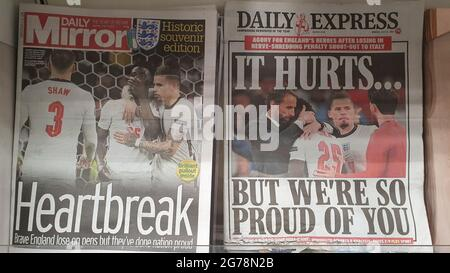 London, UK, 12 July 2021: Newspaper front pages cover England's defeat in the final of Euro 2020. The England men's football team lost on penalties to Italy at Wembley last night. The coverage emphases the disappointment but also the pride in the young at diverse team, who have sadly been subject to racial abuse online since the game. Many of the papers used photos of England manager Gareth Southgate consoling Bukayo Saka after his penalty attempt was saved by the Italian goalkeeper. Anna Watson/Alamy Live News
