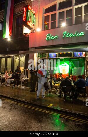 Football fans watching the match on their phones outside Bar Italia in Soho as the Euro 2020 final between England and Italy is under way.
