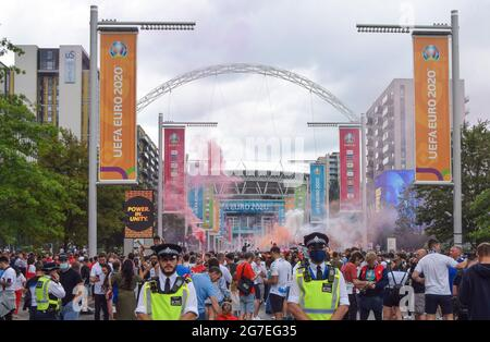 London, United Kingdom. 11th July 2021. Police officers monitor England football fans gathering outside Wembley Stadium ahead of the England v Italy Euro 2020 final.