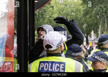 An English football fan is arrested before the England vs Italy Euro 2020 final, Leicester Square, London, 11 July 2021