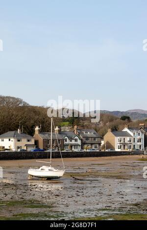 Borth y Gest, Porthmadog, Wales. Seaside landscape. Small boats on the beach at low tide in a charming coastal village. Vertical shot, copy space.