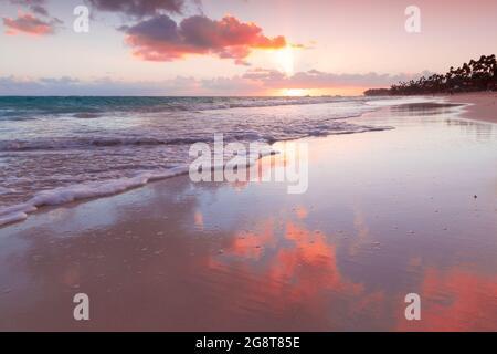 Coastal landscape with colorful sunrise sky over Atlantic Ocean, Bavaro beach, Punta Cana. Dominican Republic
