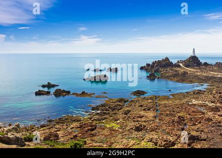 La Corbiere lighthouse on the south west corner of Jersey, Channel Islands, Britain, at low tide.