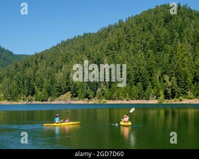 Hunter, Chester and Anabel kayaking at Larison Cove, Hills Creek Reservoir, Willamette National Forest, Oregon.