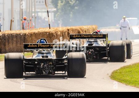 Historic Lotus 79 Formula 1, Grand Prix racing cars driving up the hill climb at the Goodwood Festival of Speed motor racing event 2014. Rear view