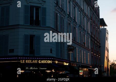 Neon sign for French restaurant Le Relais Gascon & buildings hit by setting sun on Rue Joseph de Maistre in Montmartre, 18th Arrondissement, Paris,  Î