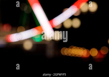 Abstract circular  bokeh background, blurred colourful night city lights.