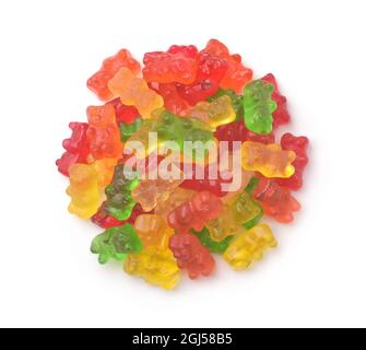 Top view of colorful gummy bears isolated on white