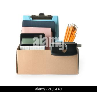 Box with personal stuff on white background. Concept of dismissal