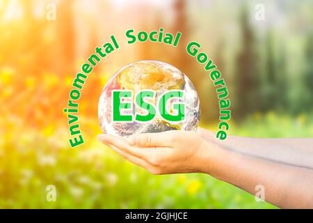 ESG modernization environmental social governance conservation and CSR policy. Planet Earth in hands on the background of nature. Ecology and nature protection concept. . High quality photo