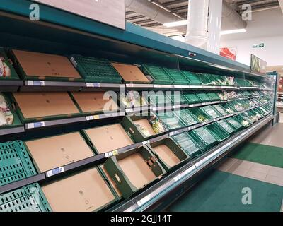 File photo dated 29/08/21 of empty shelves at Tesco Extra near Worthing, West Sussex. The boss of the Food and Drink Federation has said that the days when UK consumers could expect to pick up nearly whatever product they want whenever they want from supermarket shelves are over. Ian Wright, the body's chief executive, said that a shortage of lorry drivers is in part due to them moving to online retailers and starting to deliver for Amazon and Tesco. Issue date: Friday September 10, 2021.