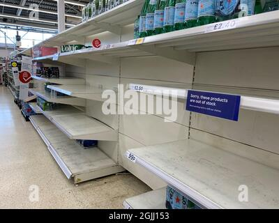 File photo dated 23/07/21 of empty shelves in the water aisle of the Tesco store at St Rollox in Glasgow. The boss of the Food and Drink Federation has said that the days when UK consumers could expect to pick up nearly whatever product they want whenever they want from supermarket shelves are over. Ian Wright, the body's chief executive, said that a shortage of lorry drivers is in part due to them moving to online retailers and starting to deliver for Amazon and Tesco. Issue date: Friday September 10, 2021.