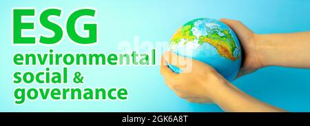 ESG modernization environmental social governance conservation and CSR policy. Earth globe in hands on a blue background. Ecology and nature protection concept. High quality photo