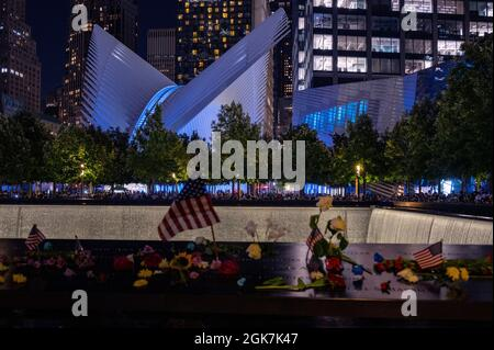 911 Memorial and Museum and the Oculus in blue Tribute Lights on the 20th anniversary of the September 11 attacks.