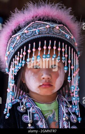 Nan, Thailand - DECEMBER 22, 2011: Portrait of a little Hmong tribe girl in traditional clothing during Hmong New Year's celebration. Khun Sathan.