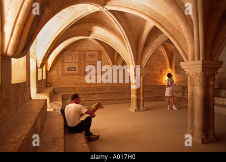 Columns archways support a room in The SENAQUE ABBEY 12th Cent CISTERCIAN PROVENCE FRANCE - Stock Photo