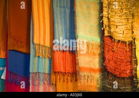 Brightly coloured fabrics on street market stall Florence Italy JMH0855 - Stock Photo