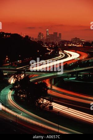 Los Angeles skyline and freeways at sunset Los Angeles California USA - Stock Photo