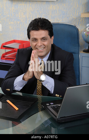 CEO in his office cabin in business suit - Stock Photo
