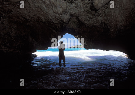 Person in Navio Beach Cave, Vieques Island, Puerto Rico, USA - Stock Photo