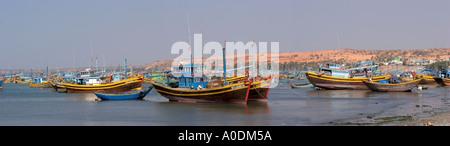 Vietnam Mui Ne fishing boats moored in Mui Ne Bay panoramic - Stock Photo
