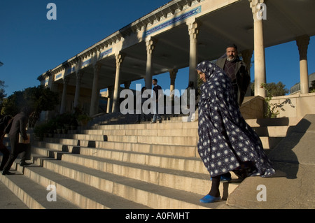 A woman on the stairways leading to the tomb of Hafez, a famous Persian poet who is revered by most Iranians, Shiraz, - Stock Photo