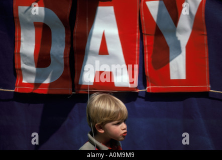 1 one young boy in front of speakers platform Loyalty day parade small town america - Stock Photo