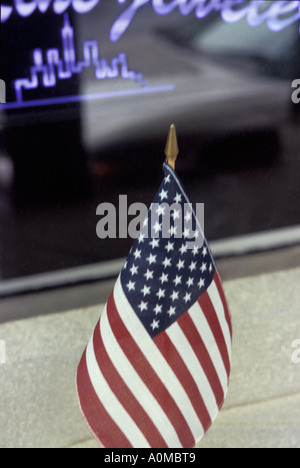 small american flag in window red white and blue - Stock Photo