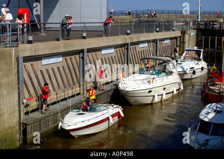 Sea going pleasure boats entering one of the locks on the Cardiff Bay Barrage Wales UK GB - Stock Photo