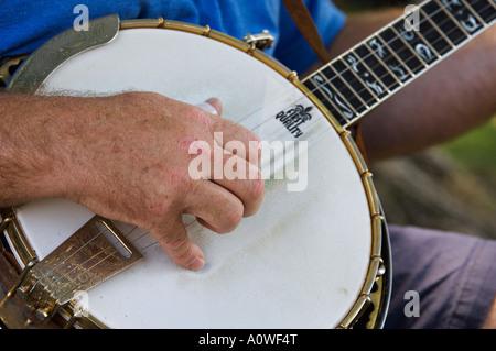 Closeup of Man Playing Banjo - Stock Photo