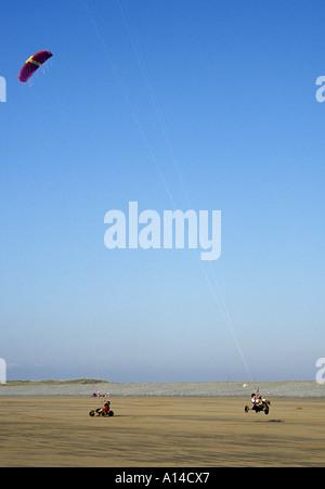 Kite Buggying on beach at Westward Ho North Devon England - Stock Photo