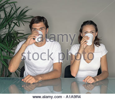 Colleagues drinking from paper cups - Stock Photo