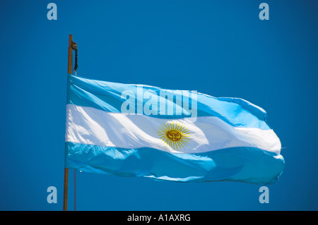 The Argentinean flag against a clear blue sky - Stock Photo